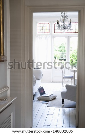 View through doorframe from hallway to living room - stock photo