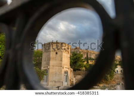 View through gate of Tower of the Wind-gods in Roman Forum and Acropolis.