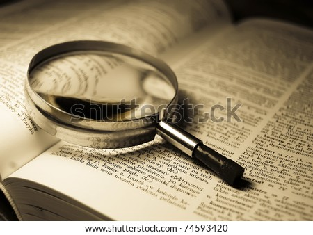 View through loupe at book - stock photo