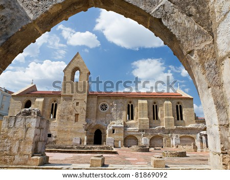 View through stone arch of Museum of excavated cloister complex Santa Clara Velha in Coimbra, Portugal