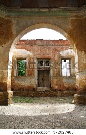 view through the Arched doors in ancient building - stock photo