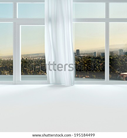 View through the windows of an urban apartment at sunset to the distant town, close up of window in a white interior wall