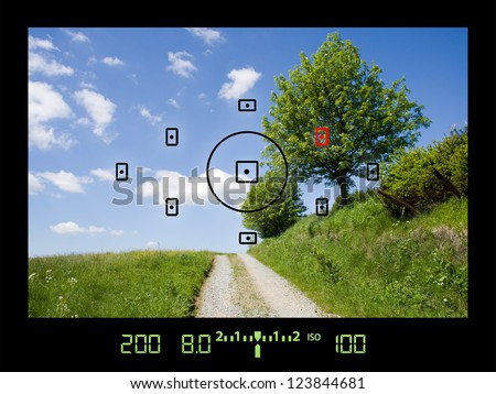 View through viewfinder during taking photos of landscape with DSLR camera - stock photo