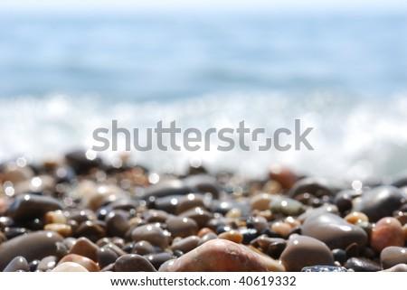 view through wet pebble on the sea - stock photo
