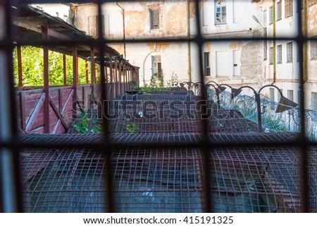 View throught the bars on Patarei prison yard, Tallinn, Estonia - stock photo