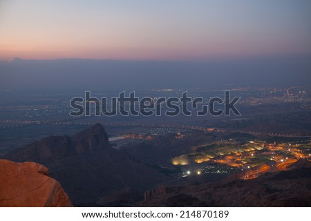 View to Al Ain (4th largest city in UAE), from the top of Jebel Hafeet mountain. Just after sunset.