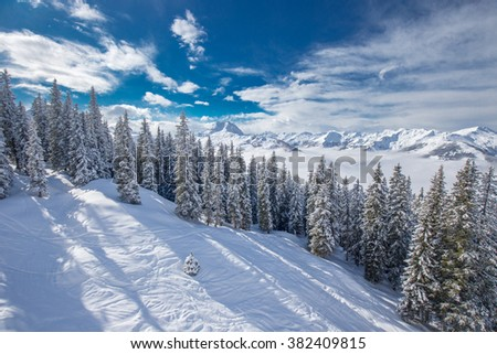 View to Alpine mountains in Austria from Kitzbuehel ski resort - one of the best ski resort in the workd with 54 cable cars, 170 km prepared skiing slopes and place of famous hahnenkamm races. - stock photo
