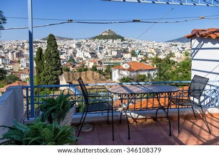View to Athens city from a balcony in Anafiotika neighborhood, Plaka, Greece - stock photo