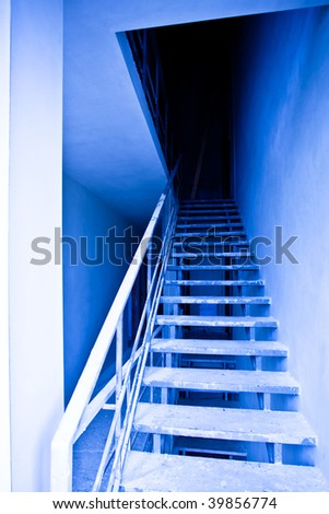View to blue empty staircase in destroyed building - stock photo