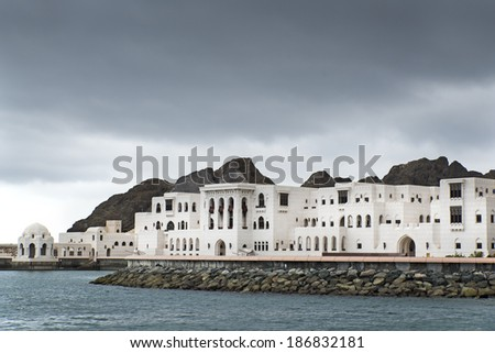 View to buildings in Muscat, Oman on a cloudy day - stock photo