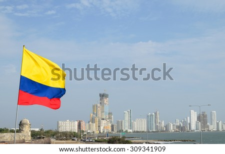 View to Colombian flag and luxury Cartagena district at seacoast