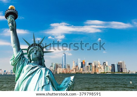 View to Downtown Manhattan and the USA flag from Liberty Island, August 2015 - stock photo
