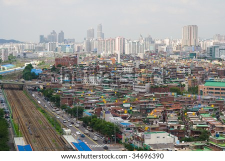 View to downtown of Seoul. South Korea. Roads, railroad, old and modern buildings - stock photo