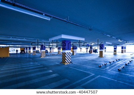 View to empty parking with several autos in blue - stock photo