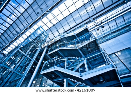 View to empty stairs in office in blue
