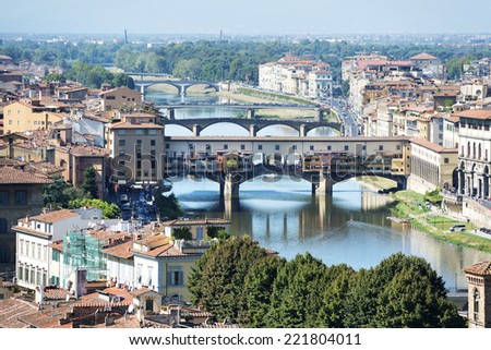 View to Florence with ponte vecchio in autumn - stock photo
