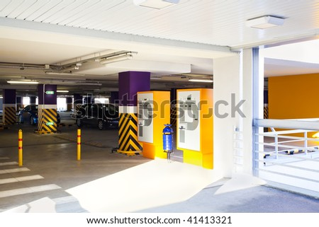 View to illuminated empty parking with two autos - stock photo