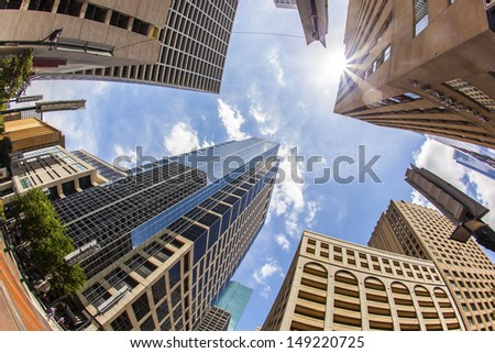 view to modern skyscraper in downtown Houston under blue sky - stock photo