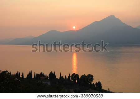 view to monte pizzocolo and garda lake at sunset, italian landscape