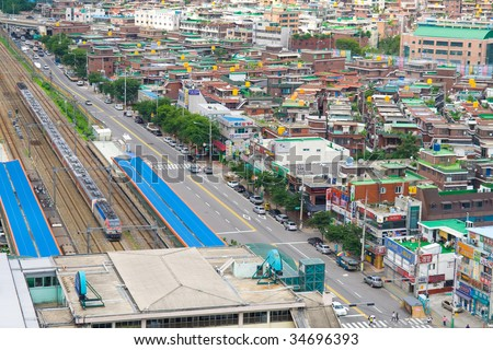 View to Seoul. South Korea. Roads, railroad, old and modern buildings - stock photo