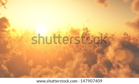 View to sunrise above the clouds from airplane - stock photo