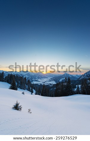 view to sunset in austrian alps at snowy winter - stock photo