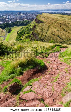 View to the City from stone footpath in mountains - stock photo
