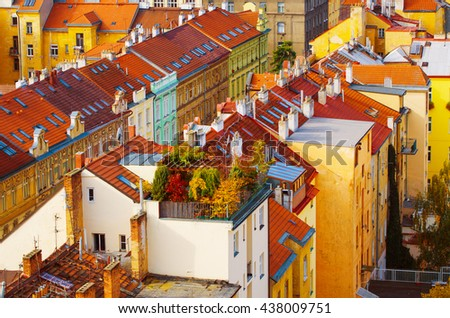 View to the colorful roofs and houses with garden of Vysegrad in Prague, Czech Republic at autumn - aerial image, travel seasonal background - stock photo