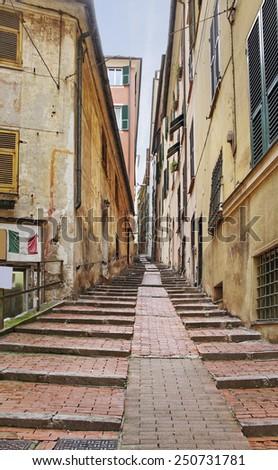 View to the narrow street of Genoa. - stock photo