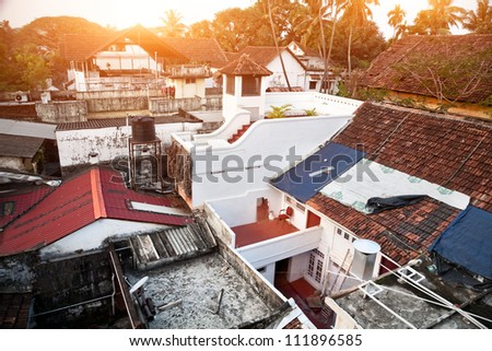 View to the roofs at sunrise background in fort Kochin, Kerala - stock photo