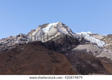 View to the summit of Island Peak from the Island Peak Base Camp. Beautiful Himalayan mountains background. - stock photo