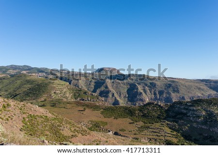 View to the tableland La Fortaleza and the mountain village Chipude situated In the highlands of La Gomera on the Canary archipelago. La Fortaleza is famous and one of the big landmarks on the Island - stock photo