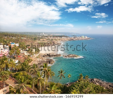 View to the tropical beach with resorts from lighthouse in Kovalam, Kerala, India - stock photo