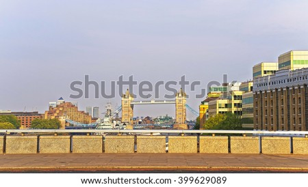View to Tower Bridge over River Thames in London, UK. Tower Bridge is suspension and bascule bridge in London. It crosses the Thames River and is an iconic symbol for London. - stock photo