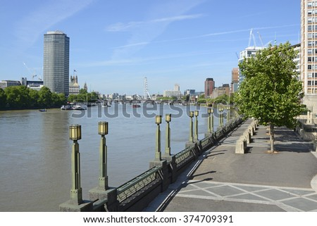 View towards city along River Thames and South Bank from Vauxhall Bridge. London. England - stock photo