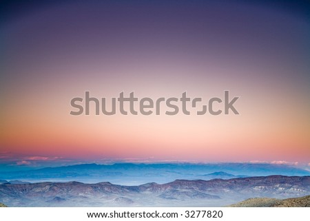 View towards distant desert mountains after the sunset. - stock photo