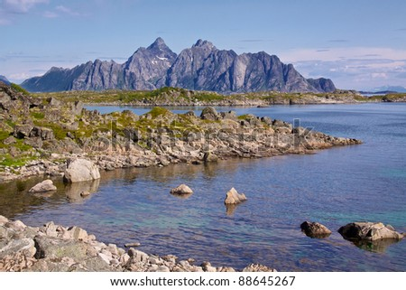View towards rocky mountains on Vestvagoy Island, favorite spot for climbers - stock photo