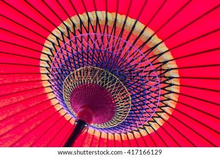 View under a bright red japanese umbrella - stock photo
