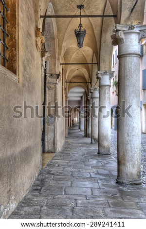 View under portico arches in Padua, Italy. - stock photo