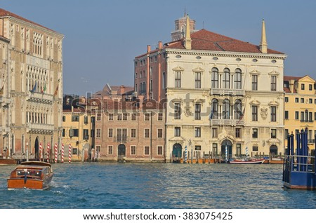 View up the Grand Canal in Venice, looking north towards San Toma with Museum of Ca'Rezzonicco on the left - stock photo