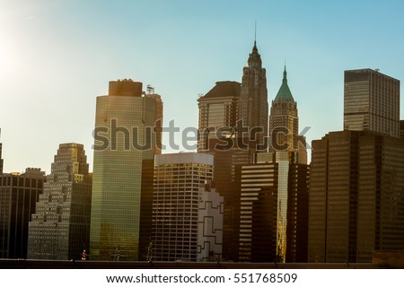 view with tall buildings, skyscrapers of new york with window glass at sunset