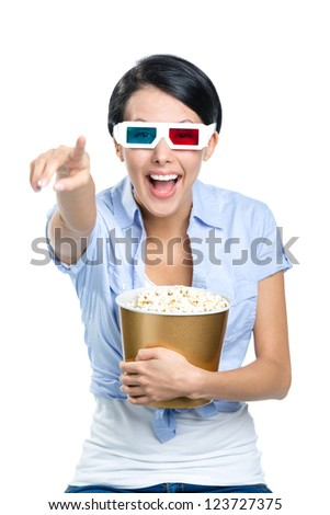 Viewer watching 3D cinema in spectacles with bowl full of popcorn, isolated on white - stock photo