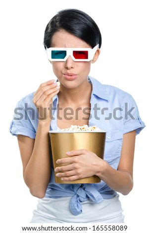 Viewer watching 3D film in glasses with bowl full of popcorn, isolated on white - stock photo