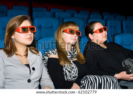 viewers with 3D glasses - three young women