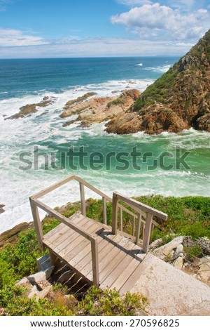 Viewing deck and ladder against beach. Shot on the Otter trail in the Tsitsikamma National Park, Garden Route area, Western Cape, South Africa.  - stock photo