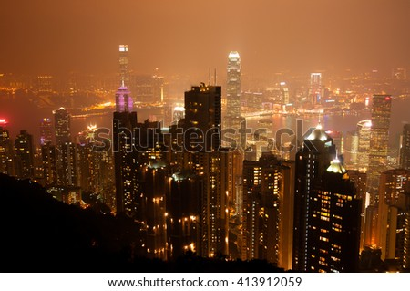 viewpoint of victoria peak at night time in orange tone