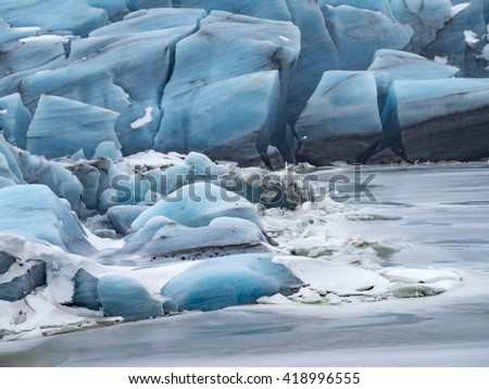 Views around a  black sand glacier beach and a glacier lagoon -Iceland, Northern Europe in winter with snow and ice