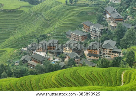 Views of green Longji terraced fields and Tiantouzhai village from viewpoint 1, China - stock photo