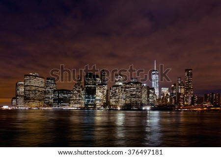 Views of Manhattan from Brooklyn in the night with  reflection in the water