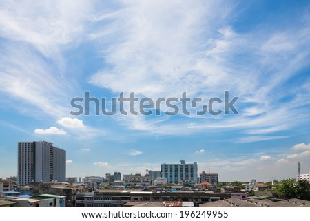 Views of the building and the blue sky with white clouds.